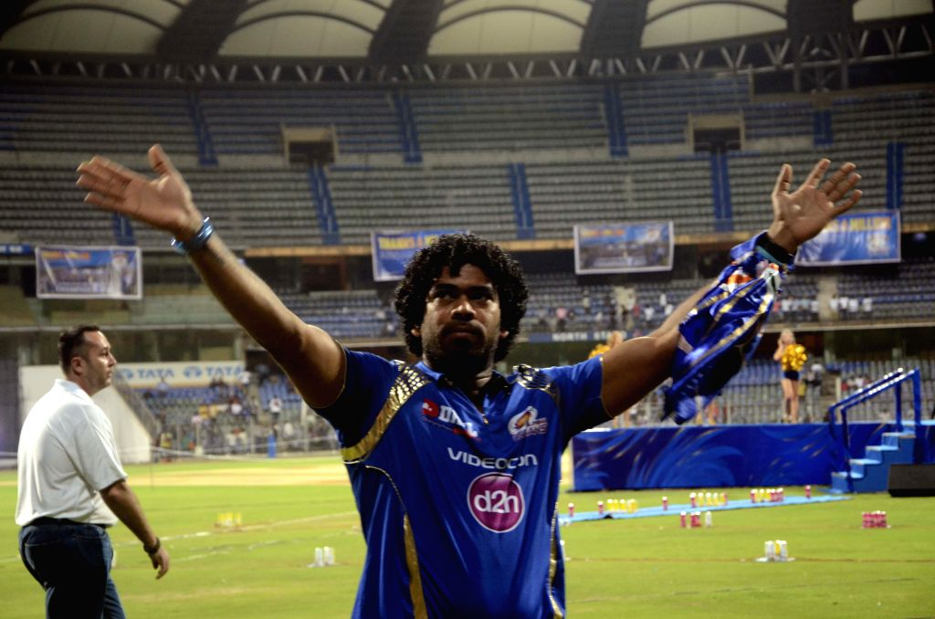 Mumbai Indians player Lasith Malinga celebrate the team's triumph in the eight edition of Indian Premier League at the Wankhede Stadium in Mumbai on May 25, 2015.