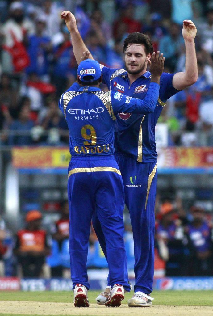 Mumbai Indians player Mitchell McClenaghan celebrates fall of Shikhar Dhawan`s wicket during an IPL-2015 match between Mumbai Indians and Sunrisers Hyderabad at Wankhede Stadium, in Mumbai, ...