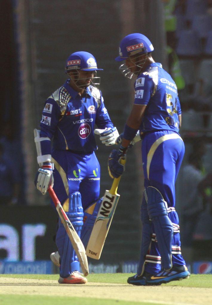 Mumbai Indians player Parthiv Patel and Lendl Simmons during an IPL-2015 match between Mumbai Indians and Sunrisers Hyderabad at Wankhede Stadium, in Mumbai, on April 25, 2015. - Parthiv Patel