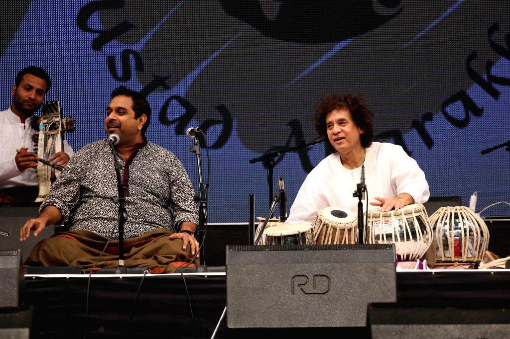 Music composer and singer Shankar Mahadevan and Tabla maestro Ustad Zakir Hussain performs during the concert organised by Ustad Allarakha Institute of Music to mark the death anniversary of . - Ustad Allarakha Khan