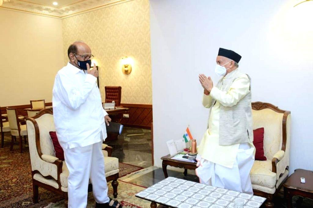 Mumbai: Nationalist Congress Party (NCP) chief Sharad Pawar and MP Praful Patel pay a courtesy call on Maharashtra Governor Bhagat Singh Koshyari at Raj Bhavan in Mumbai, on May 25, 2020. (Photo: IANS) - Praful Patel and Bhagat Singh Koshyari