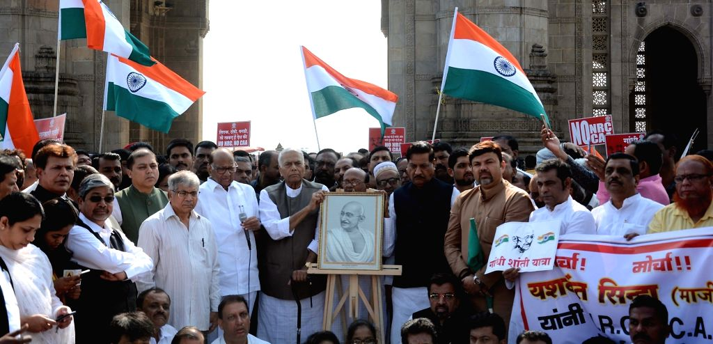 Mumbai: NCP chief Sharad Pawar along with Former Finance Minister Yashwant Sinha, flags off the 21 day-long protest march from Mumbai to Delhi against the Citizenship Amendment Act (CAA) 2019, at Gateway of India in Mumbai on Jan 9, 2020. (Photo: IAN - Yashwant Sinha