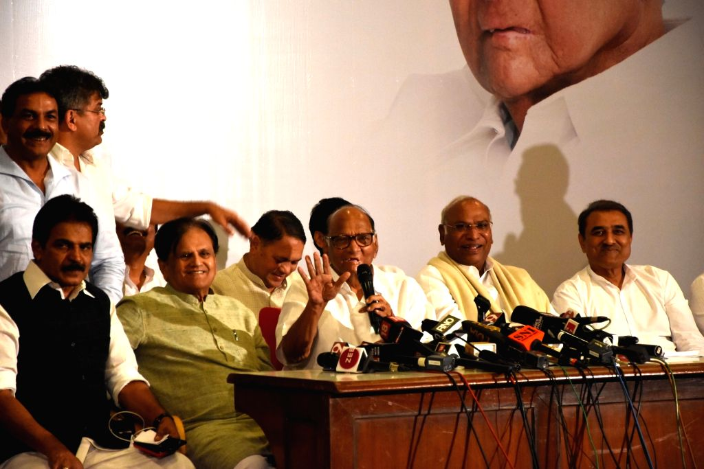 Mumbai: NCP chief Sharad Pawar, Congress leaders KC Venugopal, Mallikarjun Kharge, Praful Patel and Ahmed Patel during a joint press conference, in Mumbai on Nov 12, 2019. (Photo: IANS) - Praful Patel and Ahmed Patel