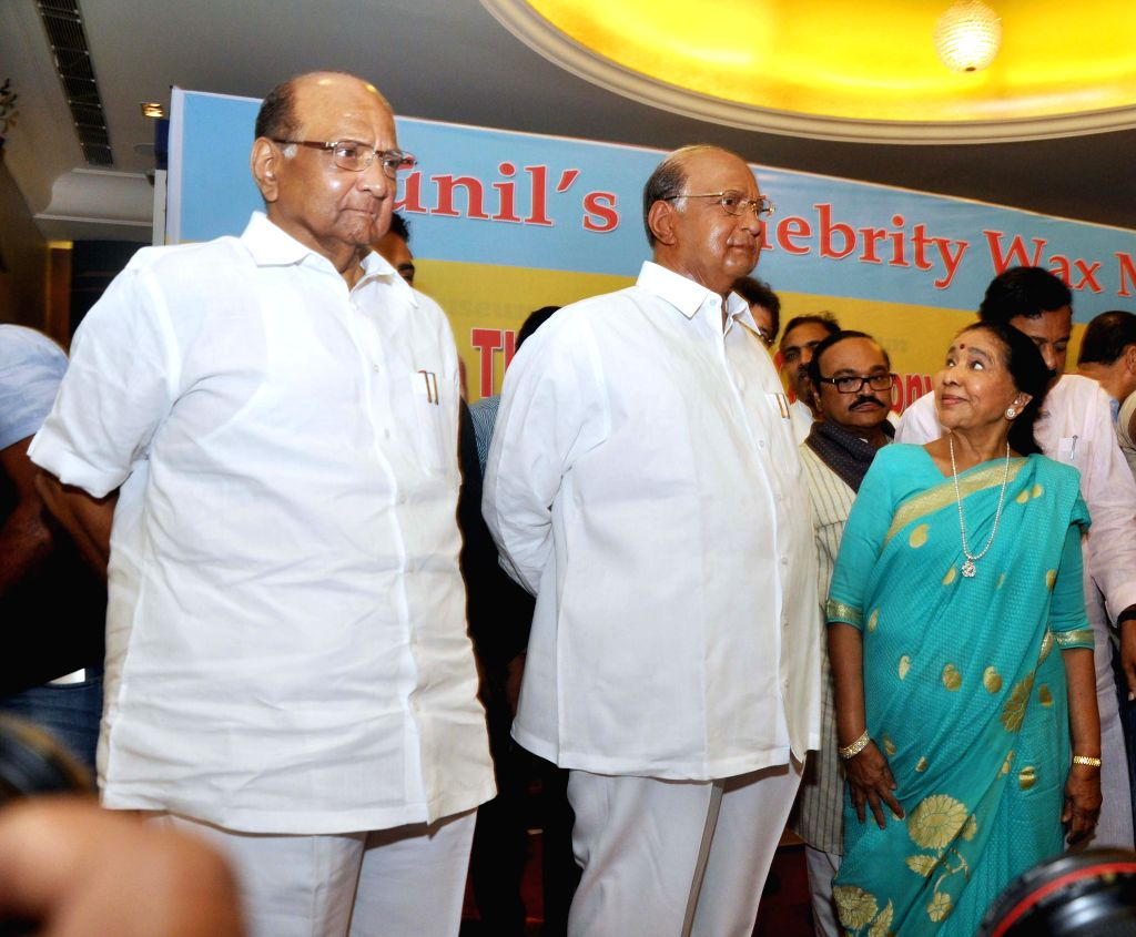 NCP chief Sharad Pawar stands besides his wax statue at Wankhede Stadium in Mumbai, on April 15, 2015. Also seen singer Asha Bhosle
