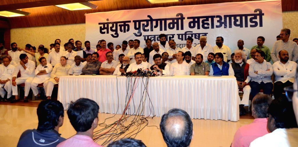 Mumbai: NCP leaders Jayant Patil, Ajit Pawar; Congress leaders Ashok Chavan, Chhagan Bhujbal, Harshavardhan Patil; Bahujan Vikas Aaghadi President Hitendra Thakur and People's Republican Party leader Jogendra Kawade during a joint press conference of - Jayant Patil and Harshavardhan Patil