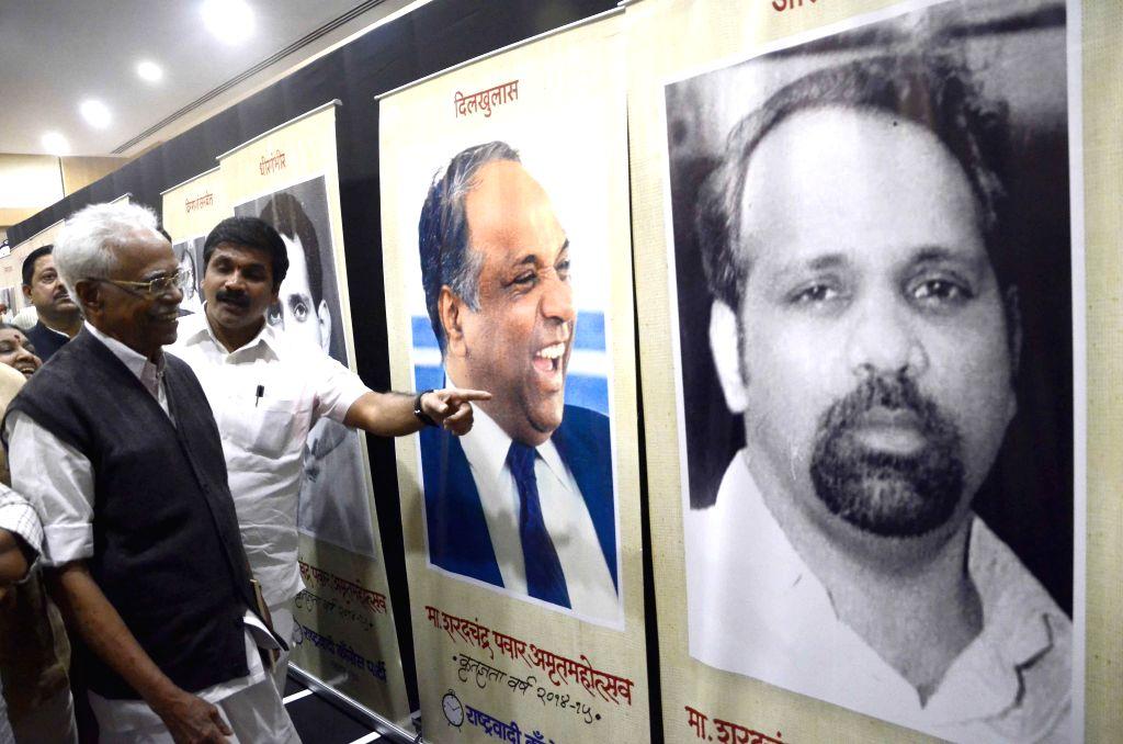 NCP leaders Pitamber Master and Sachin Ahir at the inauguration of a Photo Exhibition on the 75th birthday of Nationalist Congress Party (NCP) chief and Rajya Sabha member Sharad Pawar at ...