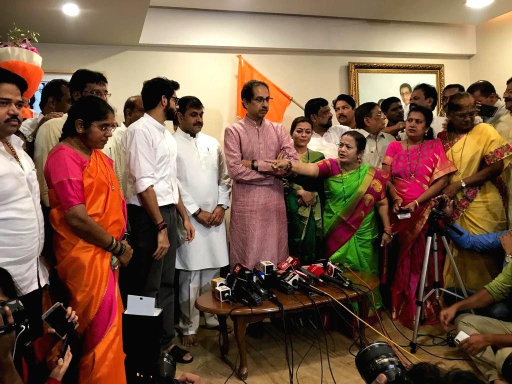 Mumbai NCP President Sachin Ahir joins Shiv Sena in the presence of party chief Uddhav Thackeray and his son Aditya Thackeray, at Bandra in Mumbai on July 25, 2019. (Photo: IANS)