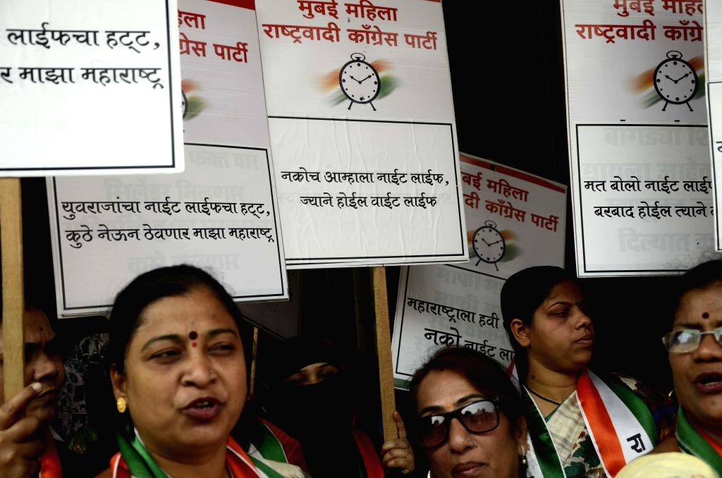 NCP women wing cell members protest against the Yuva Sena chief Aditya Thackeray`s `Night Life` plan at Churchgate Railway Station in Mumbai on Feb 24, 2015.