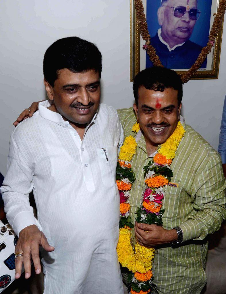 Newly elected Maharashtra Congress chief Ashok Chavan and Mumbai Congress chief Sanjay Nirupam  in Mumbai, on March 2, 2015.