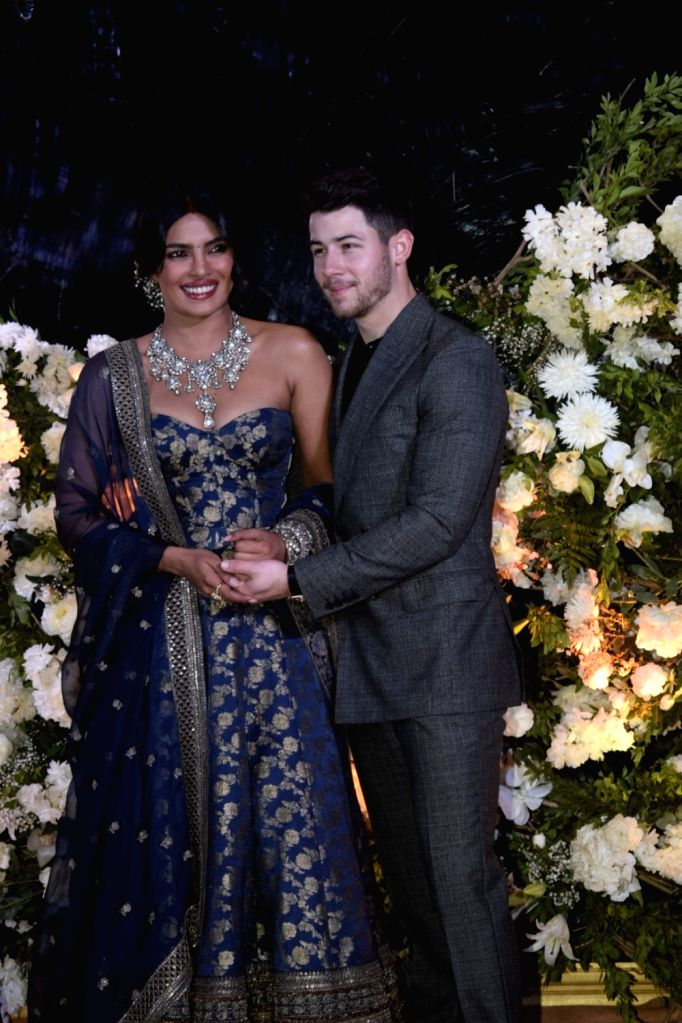Mumbai: Newlyweds Priyanka Chopra and Nick Jonas at their wedding reception in Mumbai on Dec 19, 2018. (Photo: IANS) - Priyanka Chopra