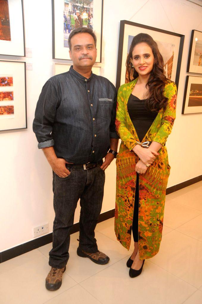 Nisheeth Bhatt with Shweta Khanduri during his photo exhibition `The Melted Core` in Mumbai, on Nov. 4, 2014.