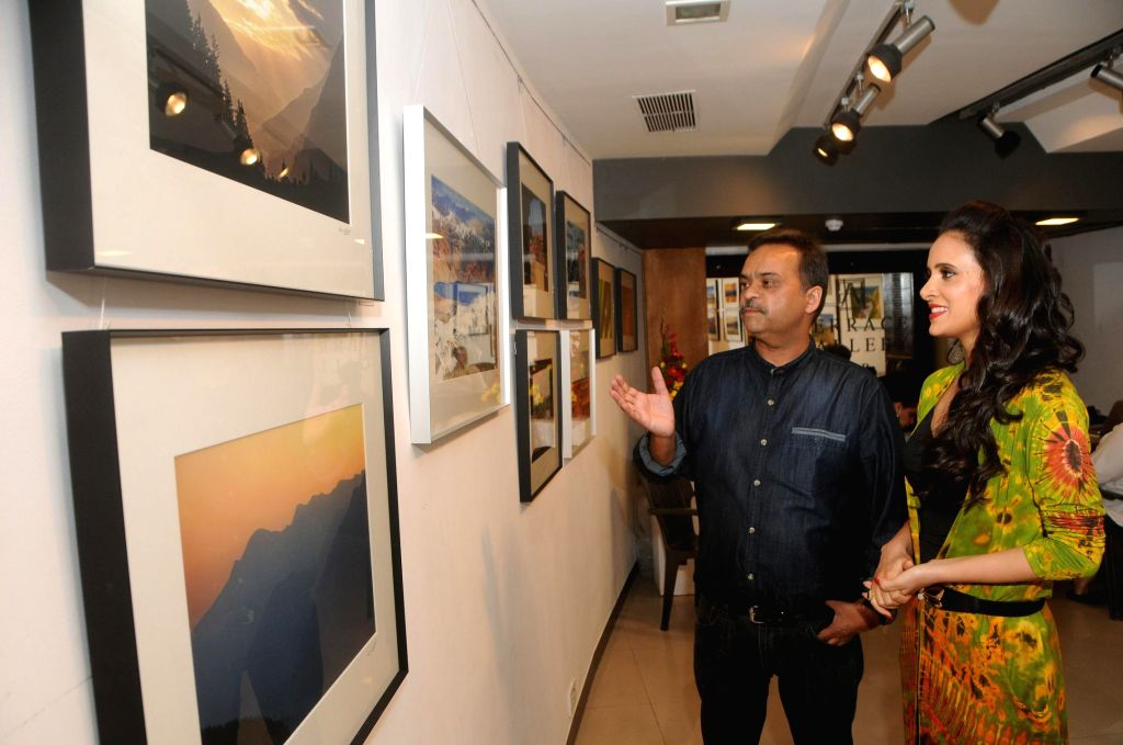 Nisheeth Bhatt with Shweta Khanduri during the photo exhibition `The Melted Core` by photographer Nisheeth Bhatt in Mumbai, on Nov. 4, 2014.