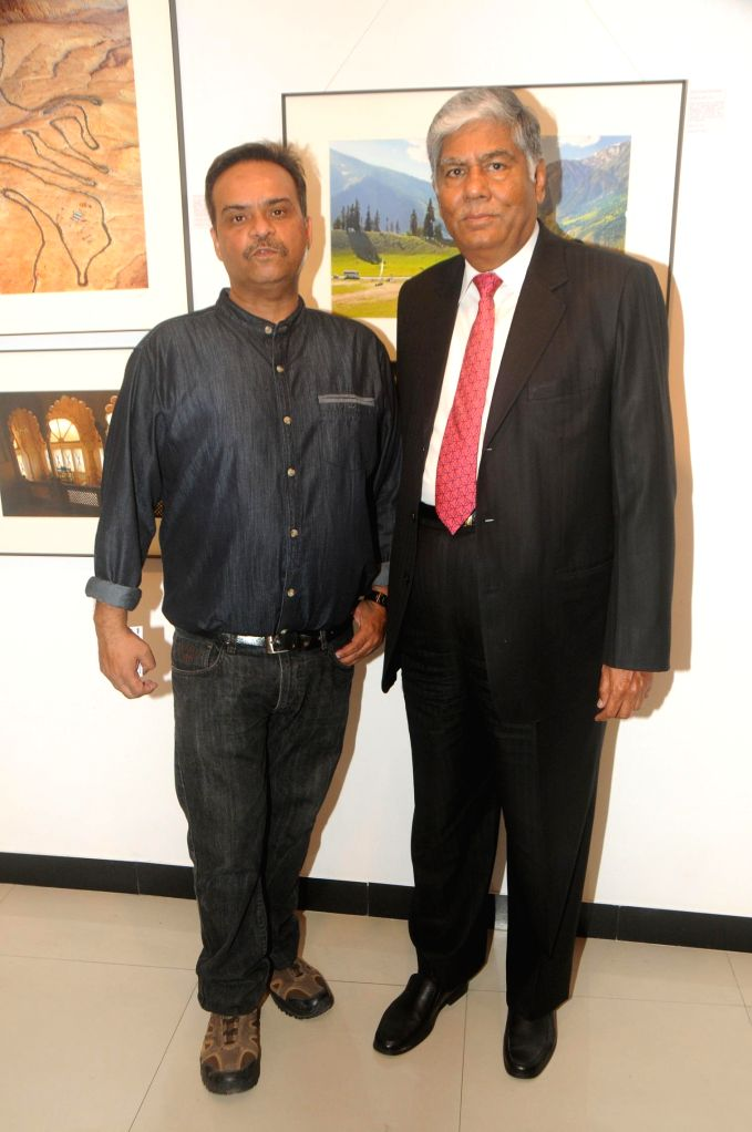 Nisheeth Bhatt with Vijay Kalantri during his photo exhibition `The Melted Core` in Mumbai, on Nov. 4, 2014.