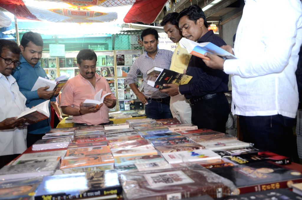 People browse through books at a book shop on World Book Day in Mumbai, on April 23, 2015.