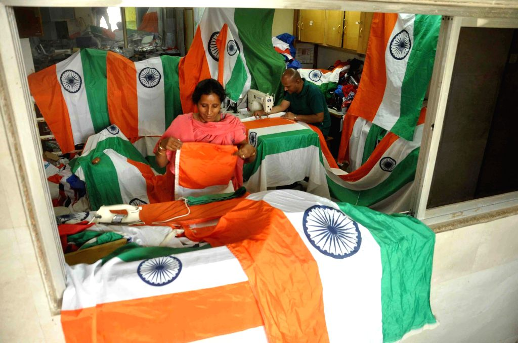 People busy stitching tricolours ahead of Republic Day at a Mumbai workshop on Jan 22, 2015.