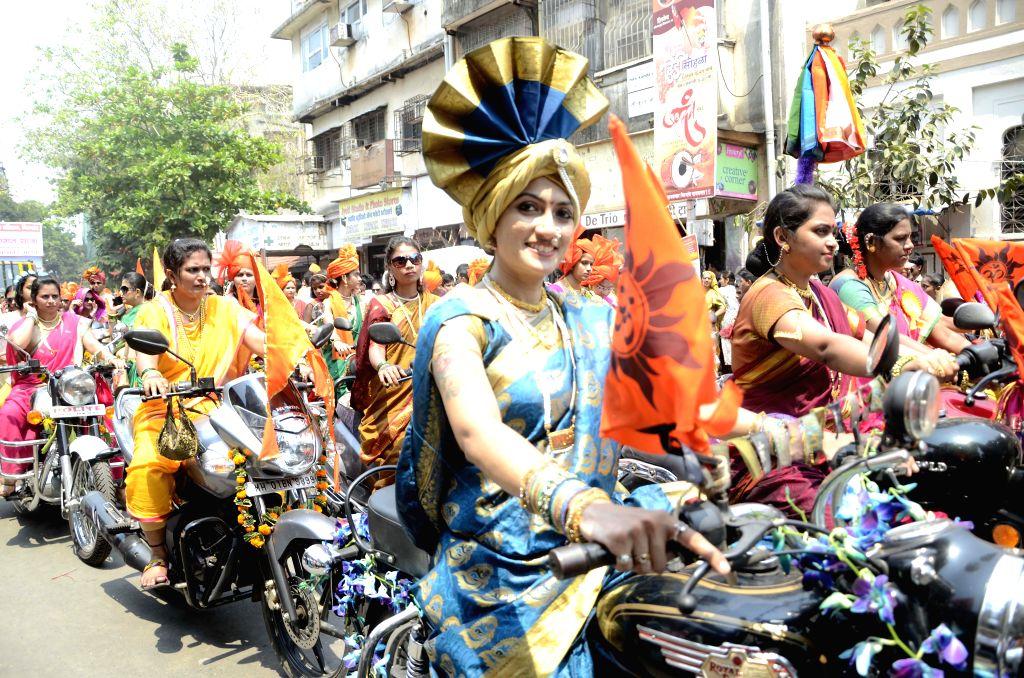 People celebrate Gudi Padwa in Mumbai on March 21, 2015.