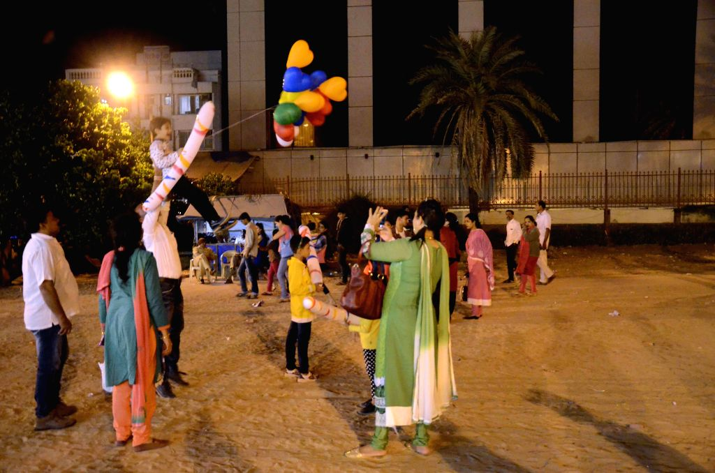 People celebrate on the new year's eve at Juhu in Mumbai on Dec 31, 2014.