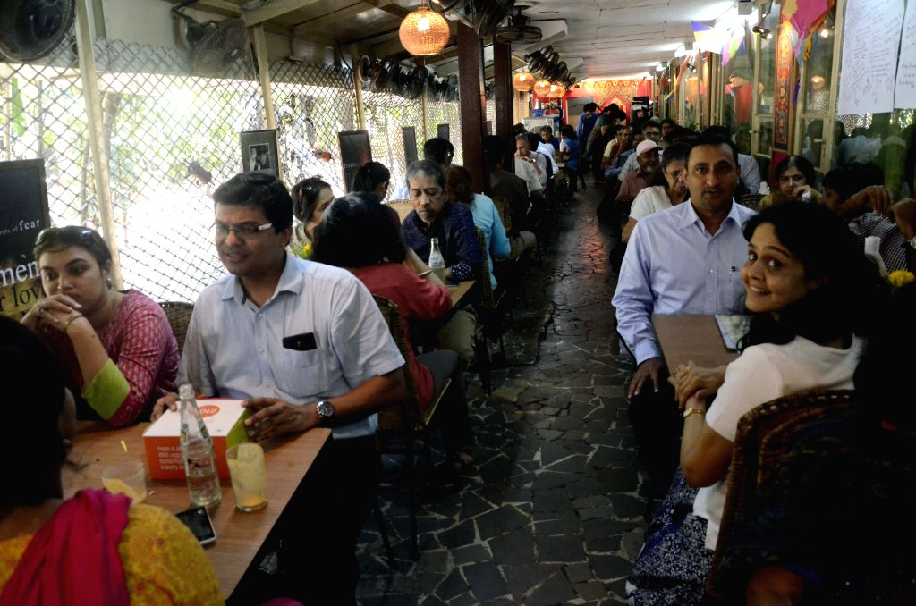People enjoy their food at the Cafe Samovar for the last time as the cafe at Jahangir Art Gallery shuts down on March 31, 2015.