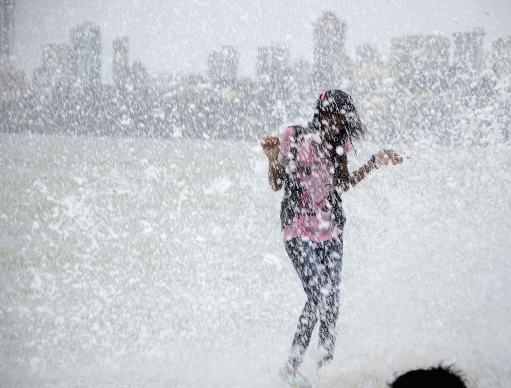 People enjoy themselves on Mumbai beach.