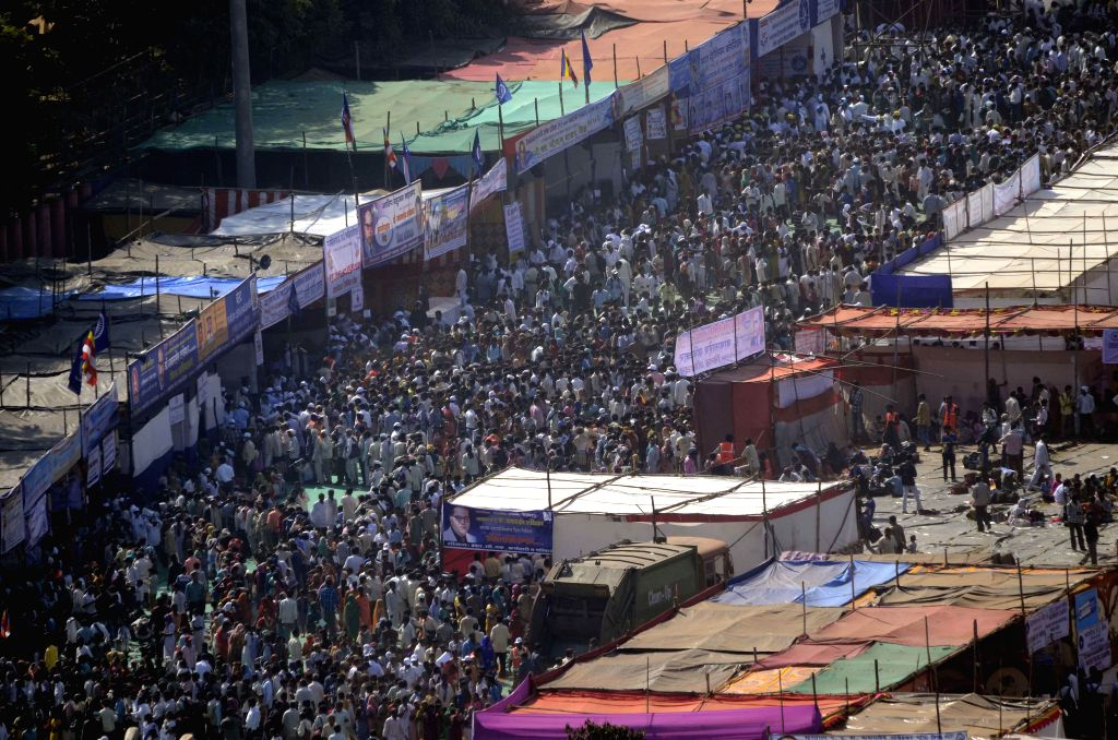 People gather in a large number to pay tribute on the occasion of Baba Saheb Dr. BR Ambedkar `Mahaparinirvan Diwas` at Shivaji Park in Mumbai on Dec. 6, 2014.