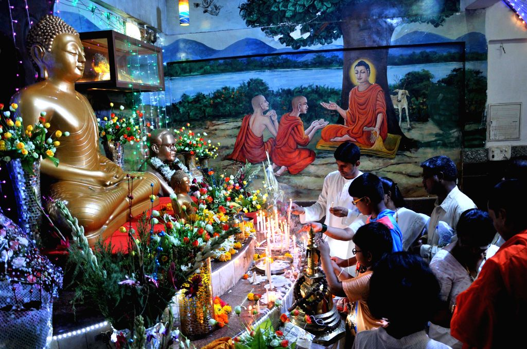 People pay obeisance at a Buddhist temple on Buddha Purnima in Mumbai, on May 4, 2015.