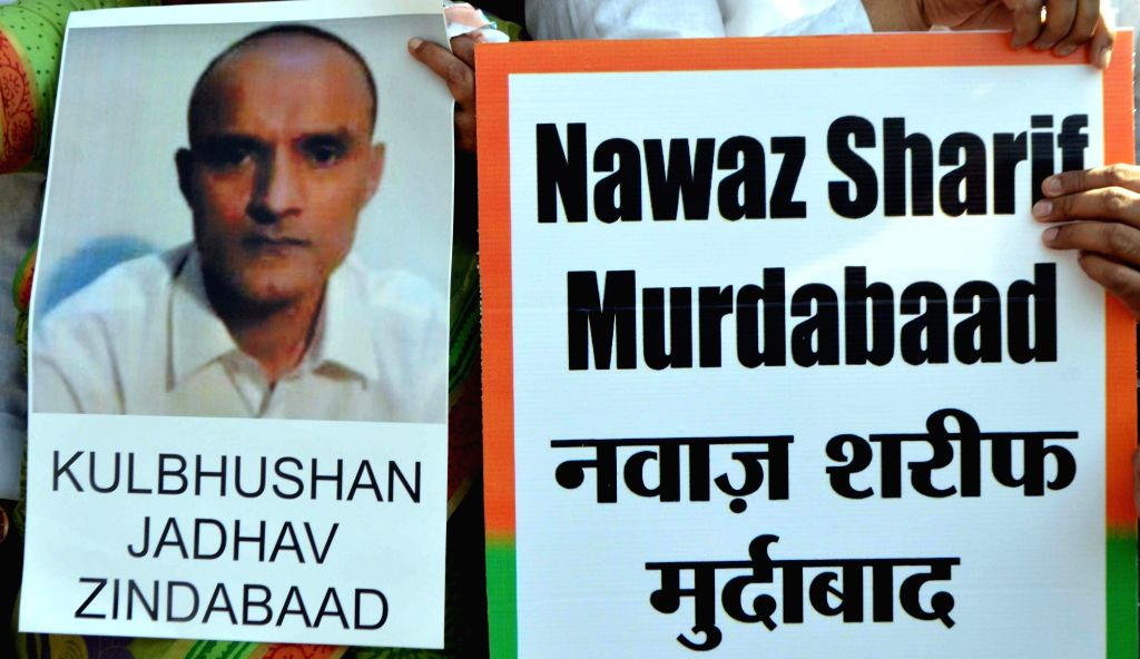 Mumbai: People stage a demonstration  after a Pakistani Field General Court Martial awarded the capital punishment to former Indian Navy officer Kulbhushan Jadhav, in Mumbai on April 12, 2017.  Jadhav was arrested on March 3, 2016, reportedly in Balo