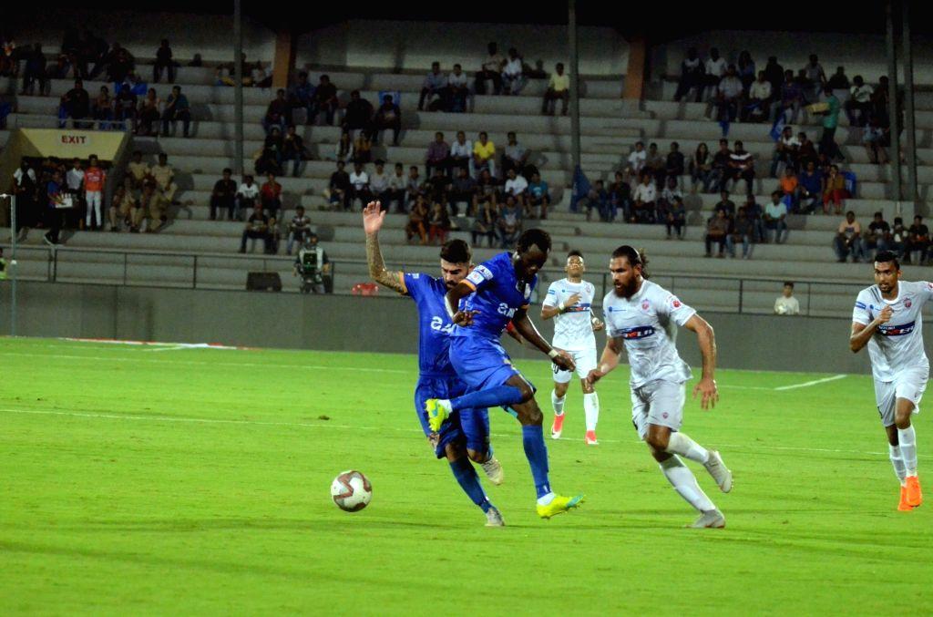 :Mumbai: Players in action during an ISL 2018 match between Mumbai City FC and FC Pune City in Mumbai on Oct 19, 2018. .