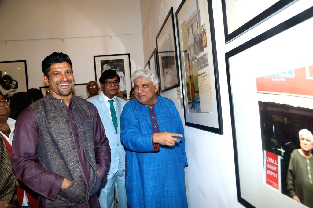 Mumbai: Poet, lyricist and screenwriter Javed Akhtar with his son Farhan Akhtar during an exhibition curated by photojournalist Pradeep Chandra and film historian SMM Ausaja on his birthday in Mumbai on Jan 15, 2020. (Photo: IANS) - Farhan Akhtar