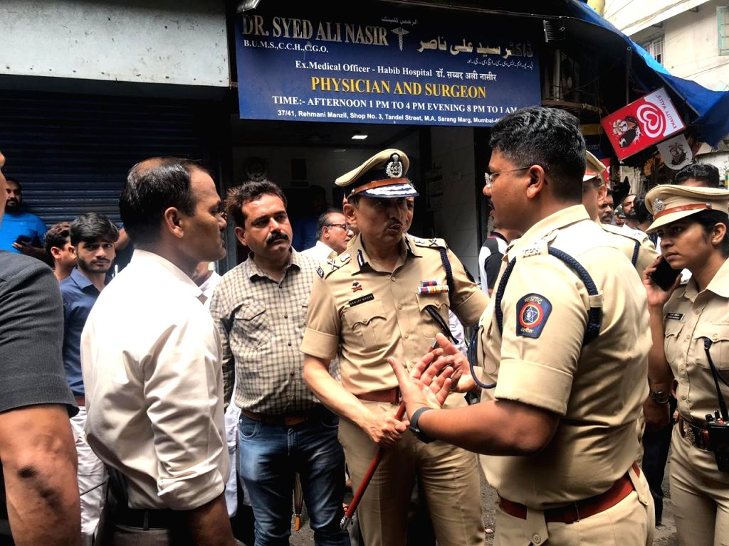 Mumbai Police Commissioner Sanjay Barve visits the site where four-storied Kesarbai Building collapsed around 11.30 a.m in south Mumbai's Dongri area on July 16, 2019. Two people were killed ...