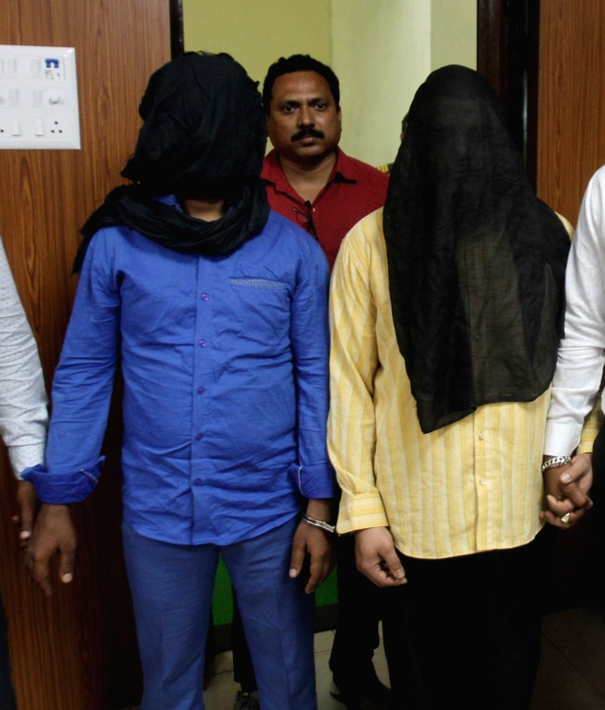 Mumbai police displays seized ornaments worth around Rs 13 lakh from a hardened chain-snatcher Md Saif Azgar Ali who was arrested from Thane railway station, in Mumbai, on May 10, 2019. He ...