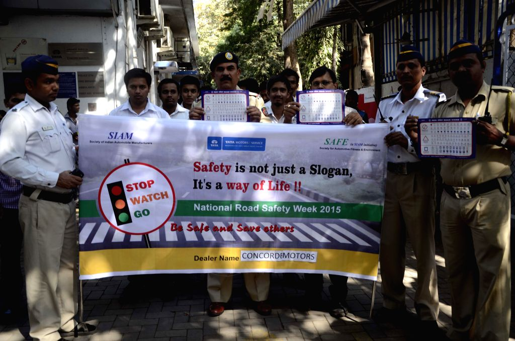 Police personnel observe Road Safety Week in Worli, Mumbai on Jan 14, 2015.