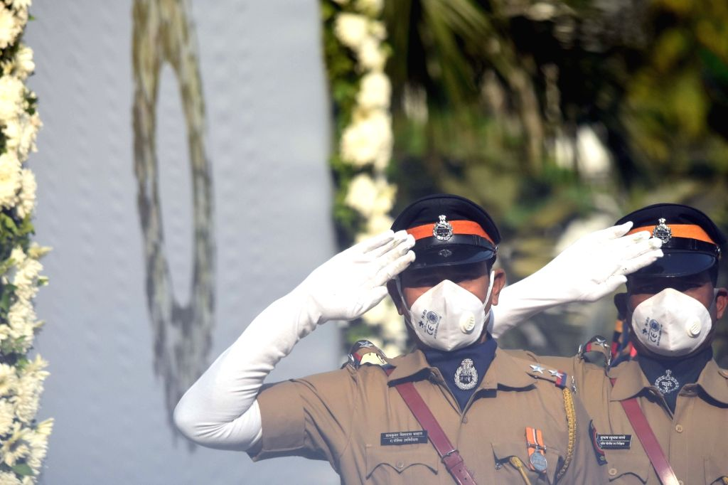 Mumbai Police personnel pay tributes to the martyrs and victims felled by bullets and brave-hearts who helped save and secure the city from the assault by 10 Pakistani terrorists, on the 12th ...