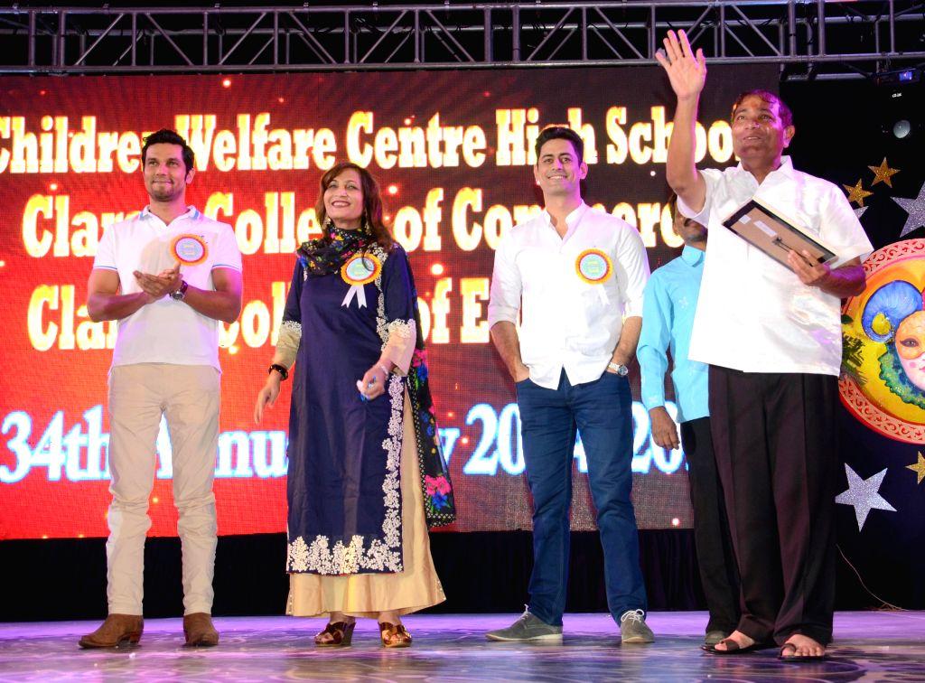 Principal Ajay Kaul with Randeep Hooda and Mohit Raina during the 34th annual day celebration of Children`s Welfare Centre High School in Mumbai, on Feb 15, 2015.