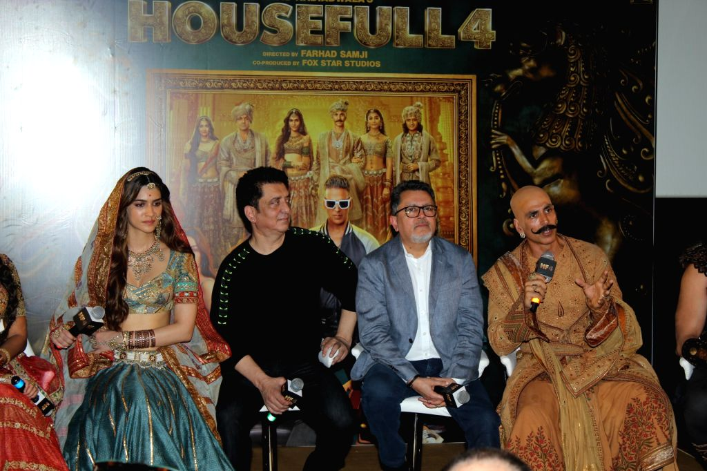 "Mumbai: Producer Sajid Nadiadwala with actors Kriti Sanon and Akshay Kumar at the trailer launch of their upcoming film ""Housefull 4"" in Mumbai on Sep 27, 2019. (Photo: IANS) - Kriti Sanon and Akshay Kumar"