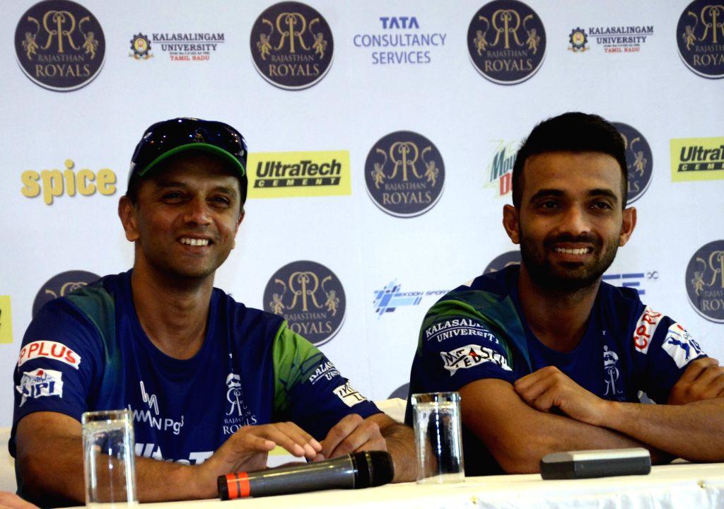 Rajasthan Royal Challengers (RRC) player Ajinkya Rahane with RRC mentor Rahul Dravid during press conference in Mumbai on April 6, 2015. - Rahul Dravid