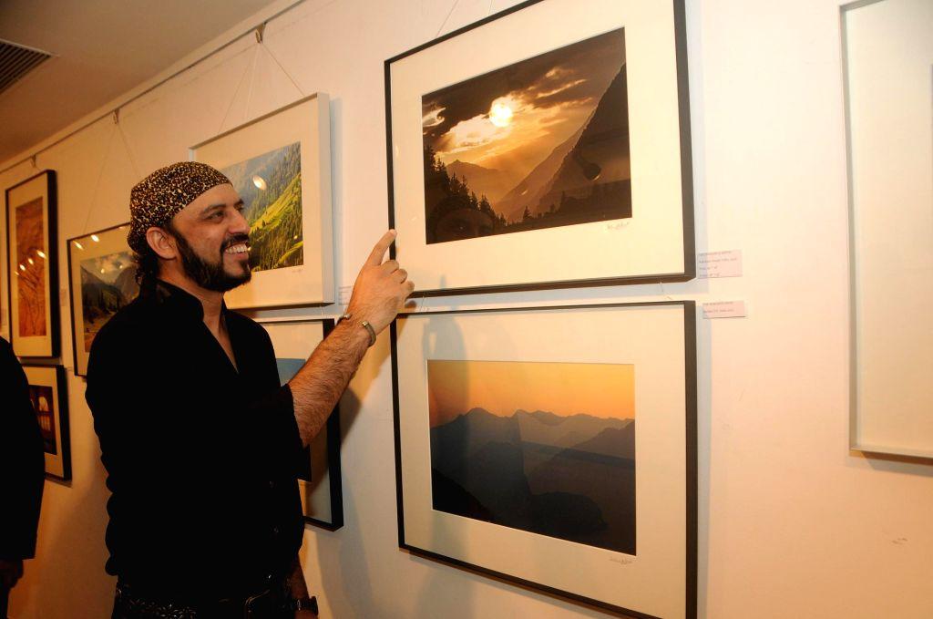 Rajeev Mahavir during the photo exhibition `The Melted Core` by photographer Nisheeth Bhatt in Mumbai, on Nov. 4, 2014.