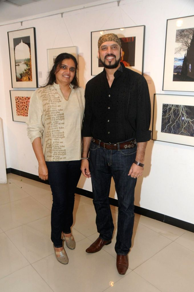 Rajeev Mahavir with Wife during the photo exhibition `The Melted Core` by photographer Nisheeth Bhatt in Mumbai, on Nov. 4, 2014.