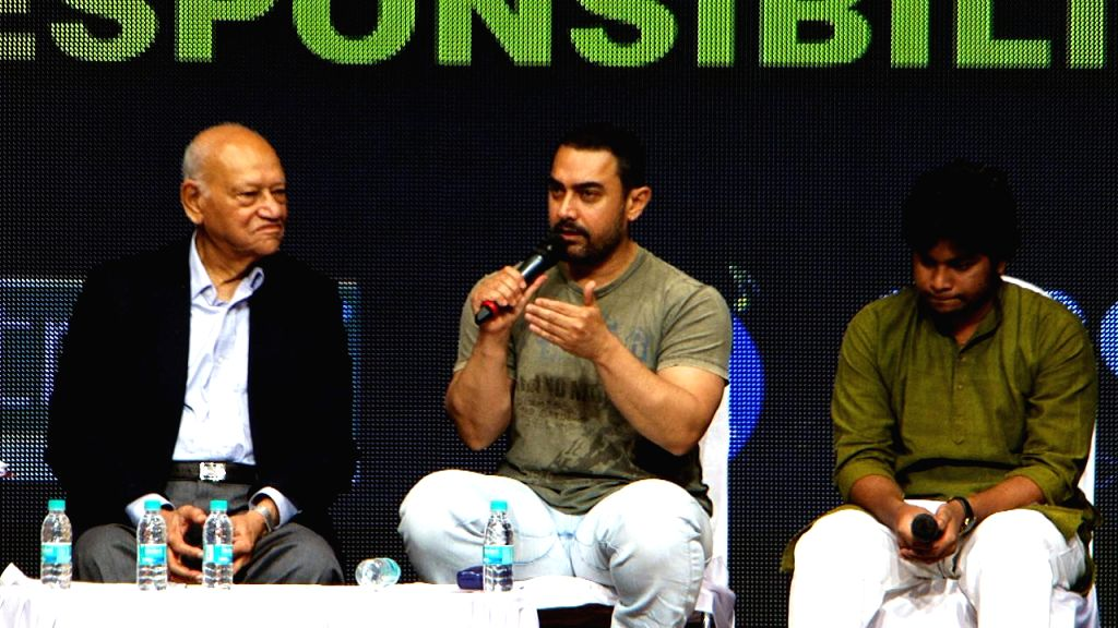 Rakesh Maria, Police Commissioner Mumbai, Bollywood actor Aamir Khan and Former Mumbai Police Commissioner Julio Rebeiro during the Youth for Governance 2015 (YFG) in Mumbai, on Feb 9, 2015.
