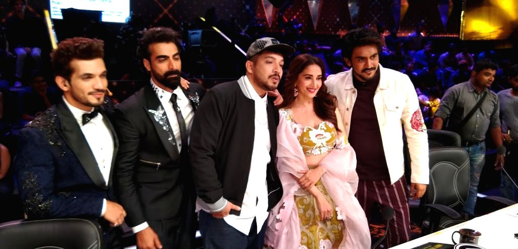"Mumbai: Rapper Naezy with the judges of the reality television show ""Dance Deewane 2"" - filmmaker Shashank Khaitan, choreographer Tushar Kalia, actress Madhuri and host Arjun Bijlani, on the sets of the show in Mumbai on June 25, 2019. (Photo: IANS) - Madhuri"