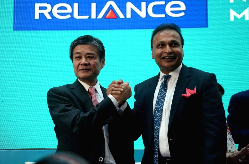 Mumbai: Reliance ADAG chairman Anil Ambani and Nippon Life Insurance Vice Chairman Takeshi Furuichi during the listing of the shares of Reliance Nippon Asset Management Company (AMC) on the National Stock Exchange (NSE) in Mumbai on Nov 6, 2017. (Pho - Ambani