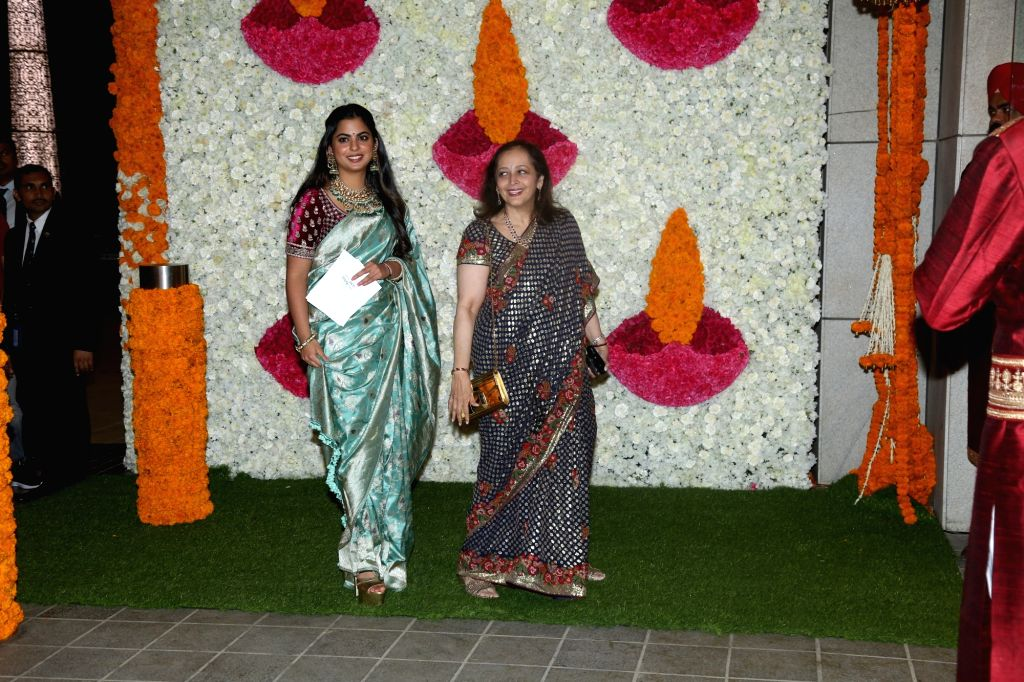 Mumbai: Reliance Industries Chairman Mukesh Ambani's daughter Isha Ambani with her mother-in-law Swati Piramal at a Diwali bash hosted by her parents in Mumbai on Oct 24, 2019. (Photo: IANS) - Mukesh Ambani and Isha Ambani
