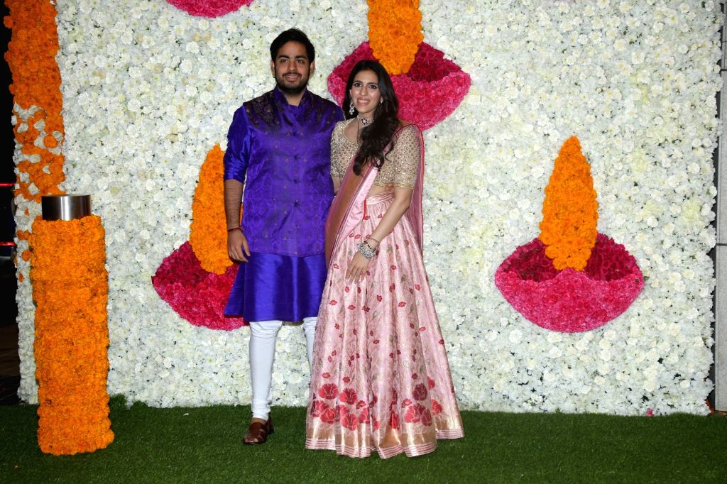 Mumbai: Reliance Industries Chairman Mukesh Ambani's son Akash Ambani with his wife Shloka Mehta at a Diwali bash hosted by his parents in Mumbai on Oct 24, 2019. (Photo: IANS) - Mukesh Ambani, Akash Ambani and Shloka Mehta