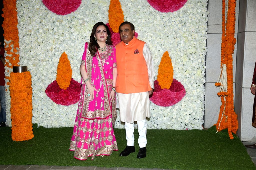 Mumbai: Reliance Industries Chairman Mukesh Ambani with his wife and Reliance Foundation Founder and Chairperson Nita Ambani at a Diwali hosted by them in Mumbai on Oct 24, 2019. (Photo: IANS) - Mukesh Ambani and Nita Ambani