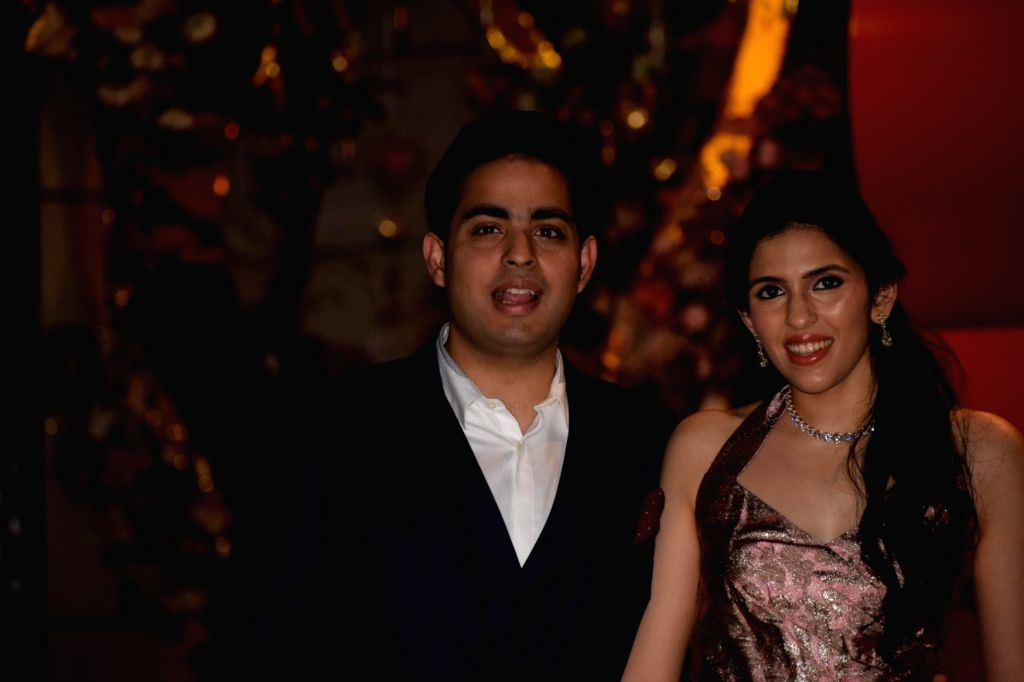 Mumbai: Reliance Industries Ltd Chairman Mukesh Ambani's son Akash Ambani and his bride-to-be Shloka Mehta at a party organised to celebrate their engagement, in Mumbai on March 26, 2018. Akash proposed to Shloka after which they got engaged at a pri - Mukesh Ambani, Akash Ambani and Shloka Mehta