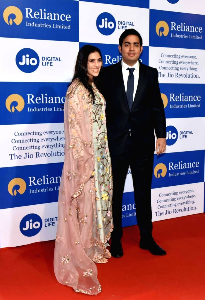 Mumbai: Reliance Jio Infocomm Ltd. Director Akash Ambani and Shloka Ambani at company's 42nd Annual General Meeting in Mumbai on Aug 12, 2019. - Akash Ambani and Shloka Ambani