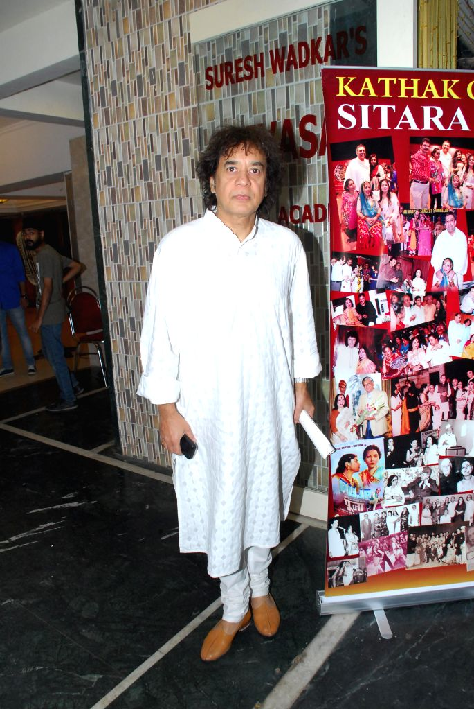 Renowned Tabla player Zakir Hussain during the condolence meeting organised in the memory of late Eminent Kathak Dancer Sitara Devi in Mumbai, on December 4, 2014.
