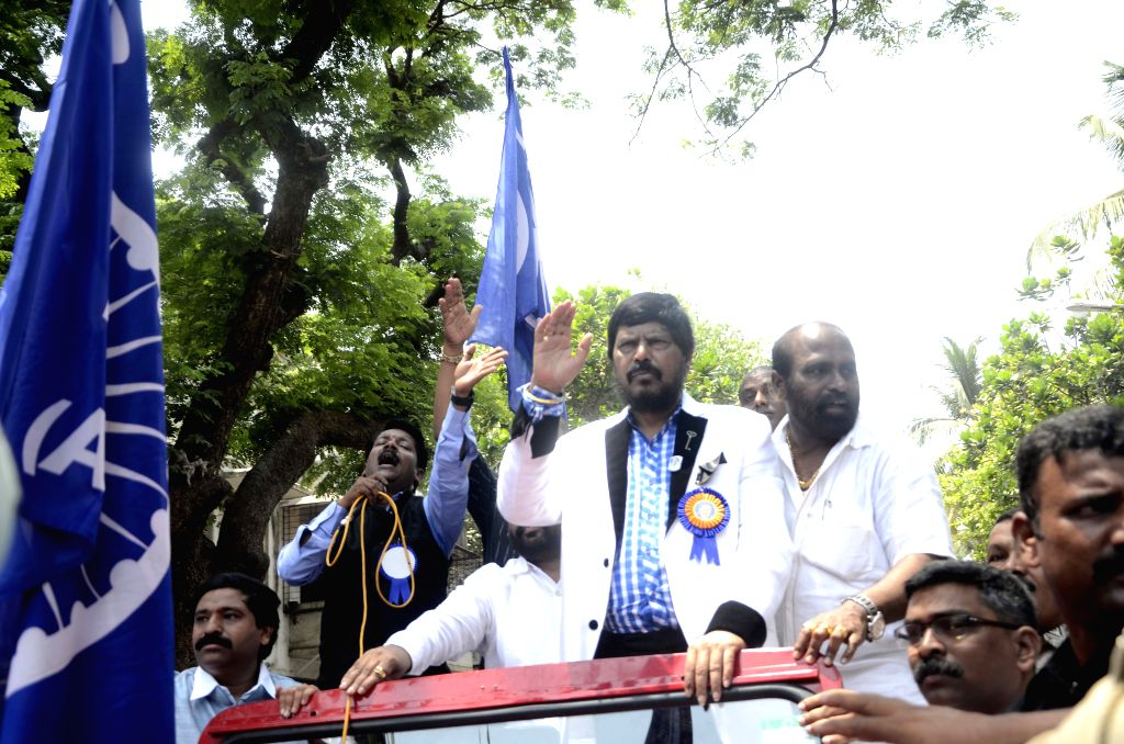 Republican Party of India (RPI) leader Ramdas Athawale participates in a procession organised to celebrate Dr. B. R. Ambedkar's birth anniversary in Mumbai, on April 14, 2015.