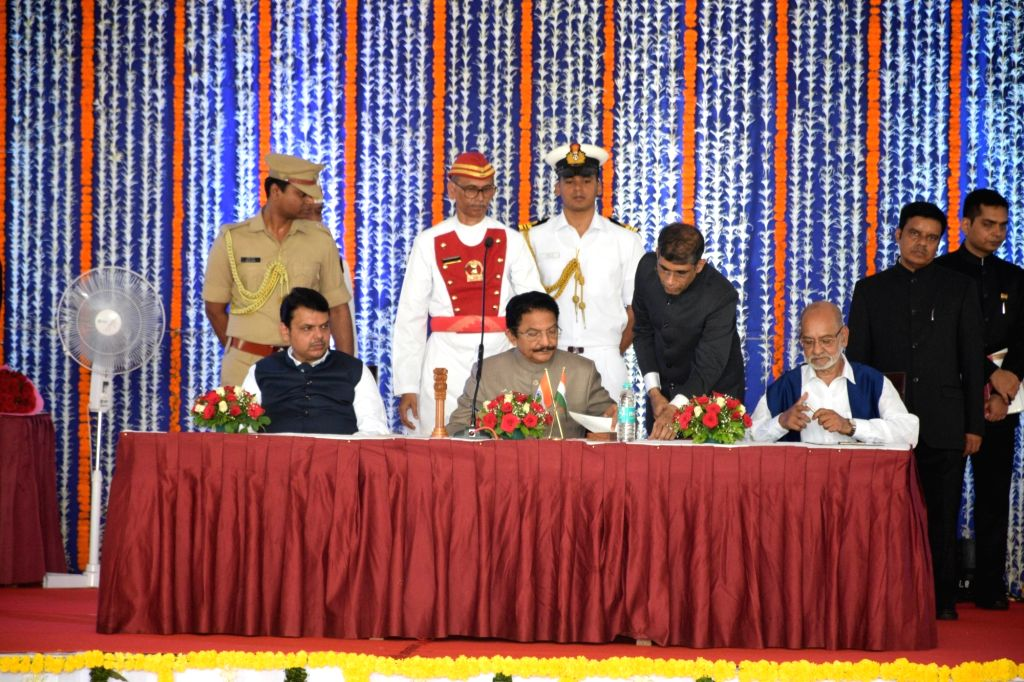 Mumbai: Republican Party of India (RPI) leader Avinash Mahtekar along with Maharashtra Governor CH Vidyasagar Rao and Chief Minister Devendra Fadnavis, after taking oath as a Cabinet Minister during a swearing-in ceremony, in Mumbai, on June 16, 2019 - Devendra Fadnavis and Vidyasagar Rao