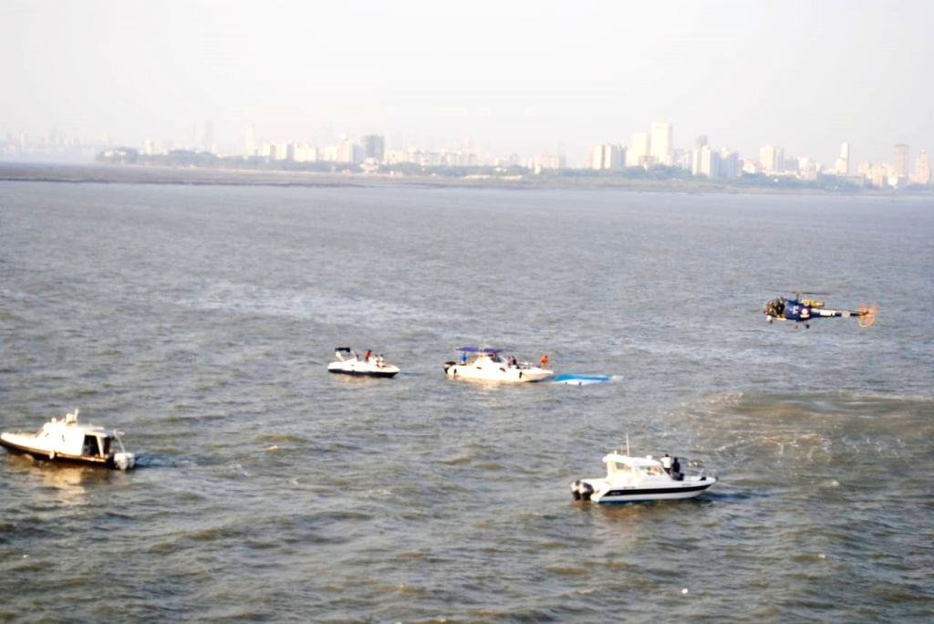 :Mumbai: Rescue operations underway after a speed boat carrying at least 40 mediapersons, TV crew and officials overturned while on a trip for a 'puja' of the proposed Chhatrapati Shivaji ...