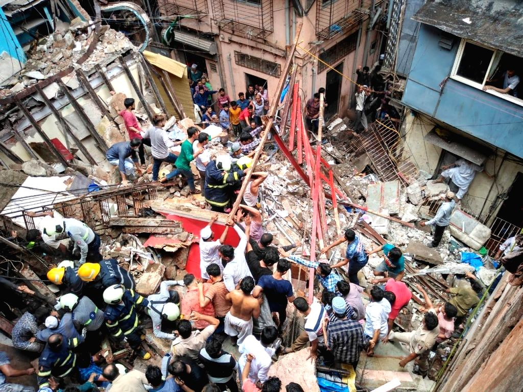 Mumbai: Rescue operations underway at Kesarbai building - a four-storey building that collapsed in south Mumbai's Dongri on July 16, 2019. At least 50 people feared trapped in the debris (Photo: IANS)